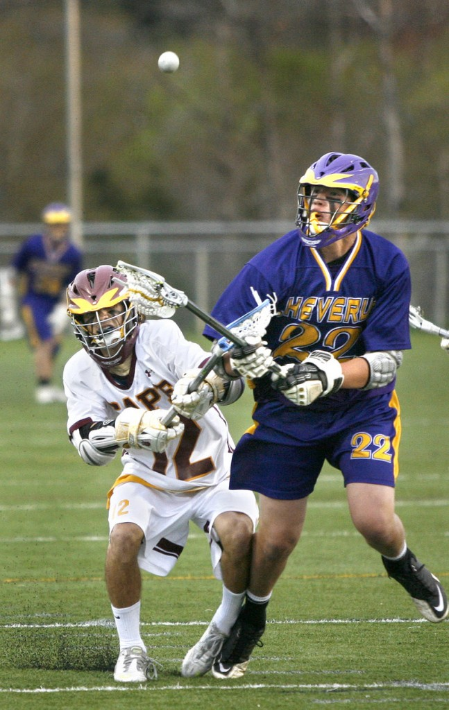Cam Olson of Cheverus, right, competes for position with Tim Lavallee of Cape Elizabeth during the Capers' 12-2 victory at home Friday night.