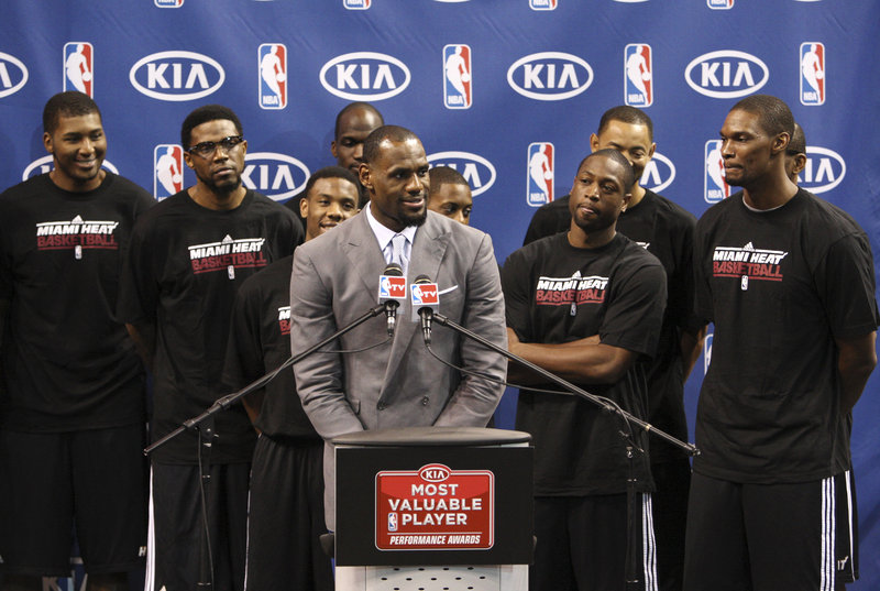 LeBron James praised his Miami Heat teammates, who surrounded him at the presentation, after being officially named Saturday as the MVP of the NBA for the third time.