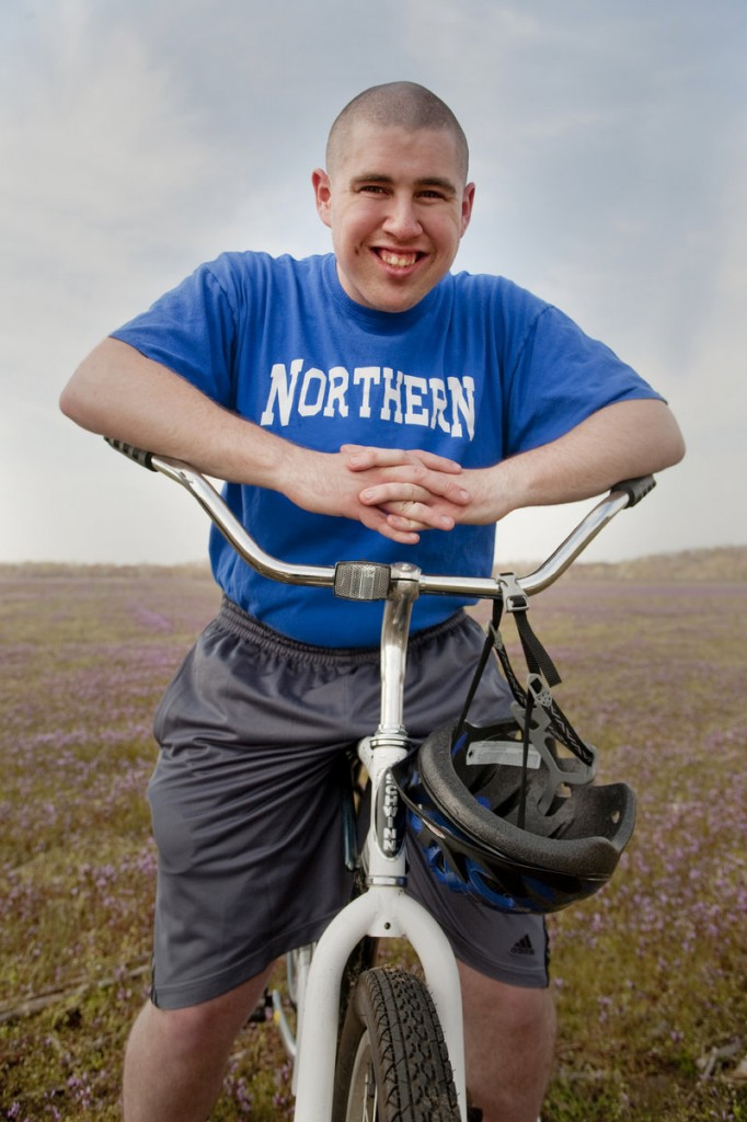 Ian Wells sits on his bike in North Hanover, N.J., last year. Wells, now 21, has autism and has had trouble finding paid employment.