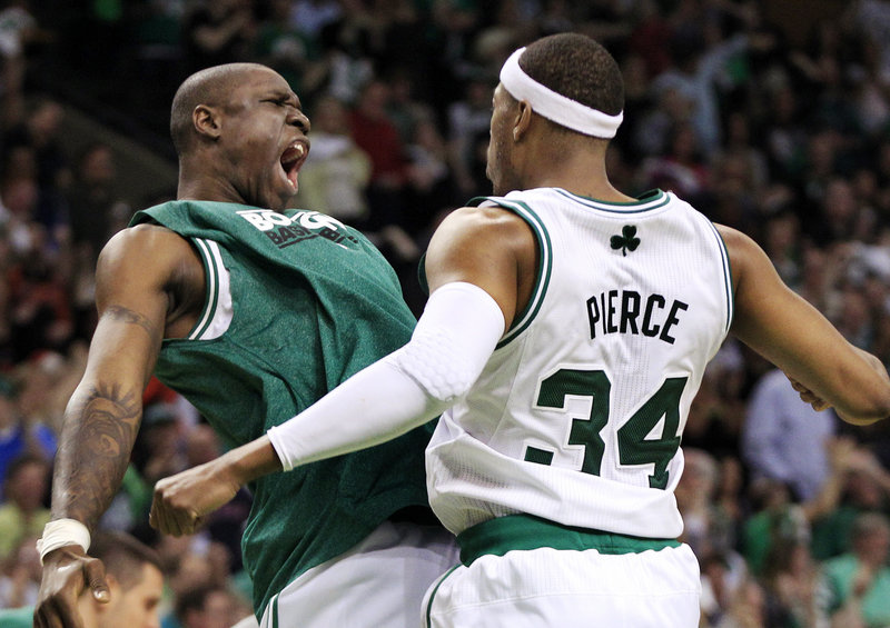 Paul Pierce, right, rejoices with Mickael Pietrus late in Saturday night's win over the 76ers in the opener of their Eastern semifinal series.