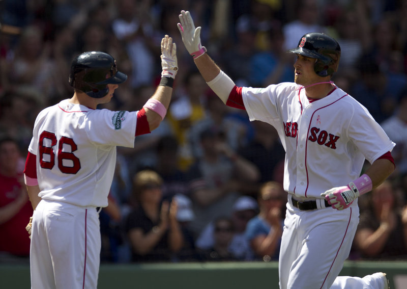 Will Middlebrooks, right, is welcomed by Daniel Nava after hitting a homer in Sunday's game. Middlebrooks has four homers in 10 games.