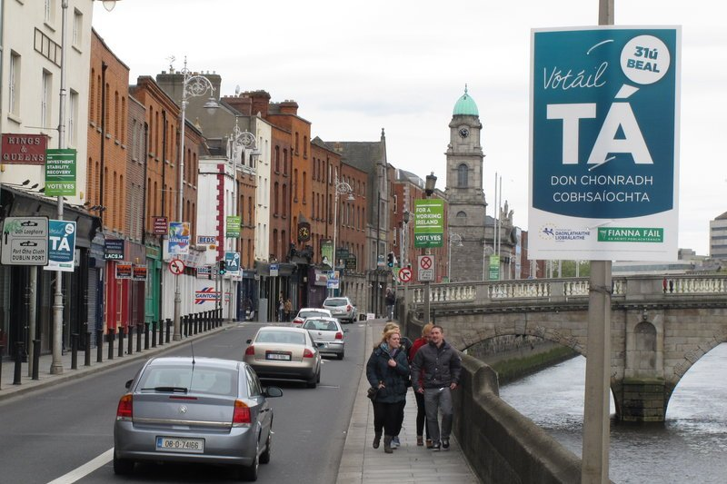 Referendum posters line a riverside street in Dublin Sunday. The Irish government is asking voters to approve the European Union's fiscal treaty in a May 31 vote. The poster in the upper right advises