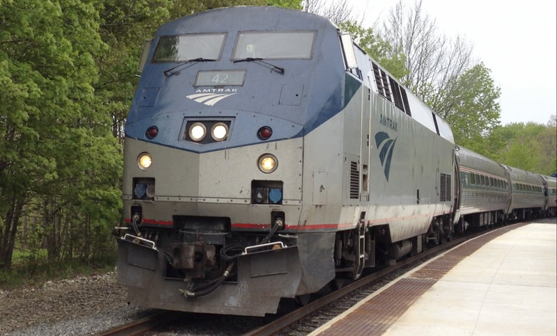 The Downeaster arrives in Freeport on Monday as transportation officials celebrated the completion of passenger platforms in Freeport and Brunswick in advance of expanded passenger train service starting in November.