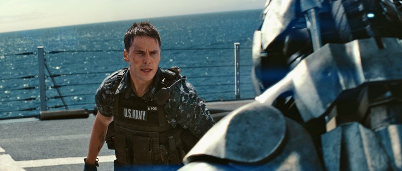 Taylor Kitsch comes face to face with an alien invader.