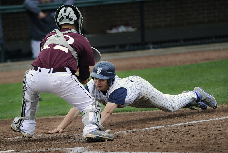 Tim Rovnak of Portland tries to score, but is blocked off the plate by Windham catcher Jack Herzig in Monday's baseball game at Hadlock Field. Windham won 8-3 as Shawn Francouer had four hits and three RBI.