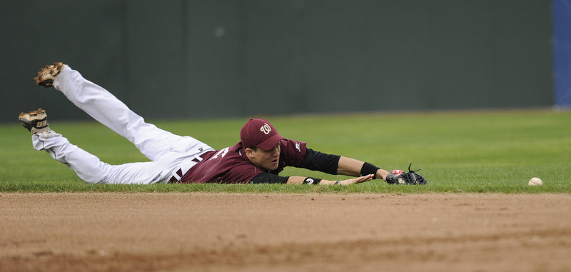 Johnny Weymouth of Windham can't reach a grounder Monday against Portland, but the hit didn't prevent the Eagles from earning an 8-3 victory at Hadlock Field.