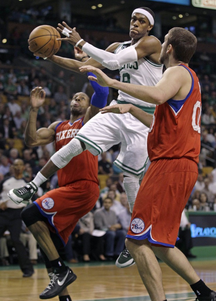 Rajon Rondo passes the ball under pressure from Philadelphia's Andre Iguodala as the 76ers took an 82-81 win Monday night to even their playoff series at 1-1.
