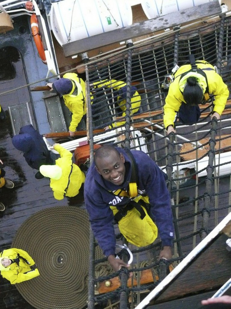Coast Guard Cadet Orlando Morel climbs rigging aboard the Coast Guard Cutter Eagle. The Coast Guard rescued him and his mother when he was a boy.