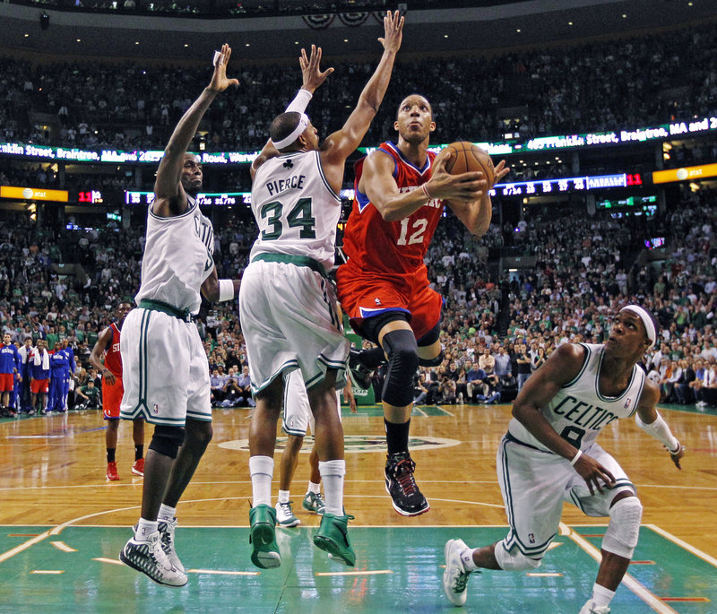Evan Turner gets in front of Celtics defenders Kevin Garnett, left, and Paul Pierce to score the go-ahead basket in the final minute Monday of Philadelphia's 82-81 win.