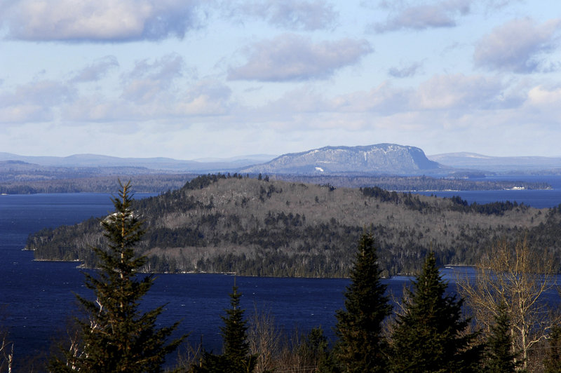 Mount Kineo rises near Moosehead Lake. The conservation easement covering 363,000 acres in the region is one of the largest in U.S. history, according to participants in the deal. They also hope the agreement will boost recreational tourism and improve the area's struggling economy.