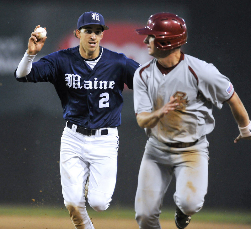 Michael Fransoso of the University of Maine has the ball right where he had it most of the night Tuesday at Hadlock Field – in his hand and ready for a putout. Fransoso, who had a hand in 11 of the 27 outs, chases down Tom Bourdon of BC, caught in a rundown.