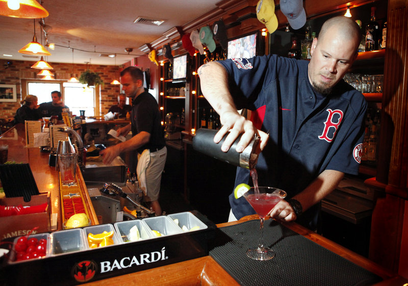 Bartender Nathan Dumas whips up a blueberry martini at Alisson's.
