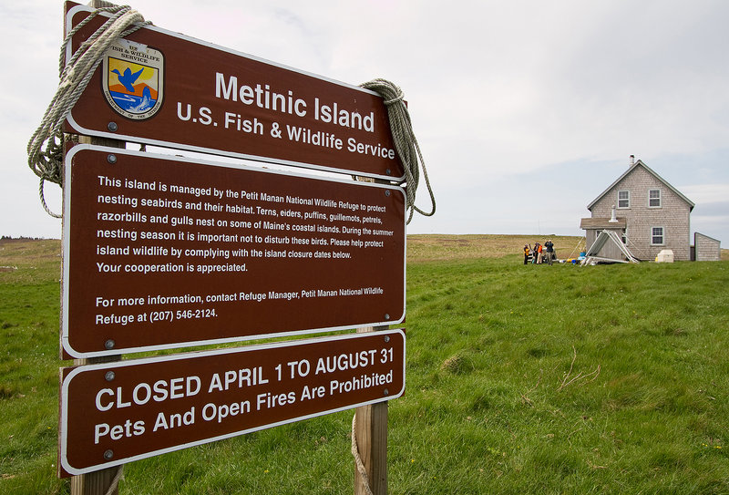 A U.S. Fish and Wildlife Service sign marks Metinic Island, which is the home of nesting seabirds.