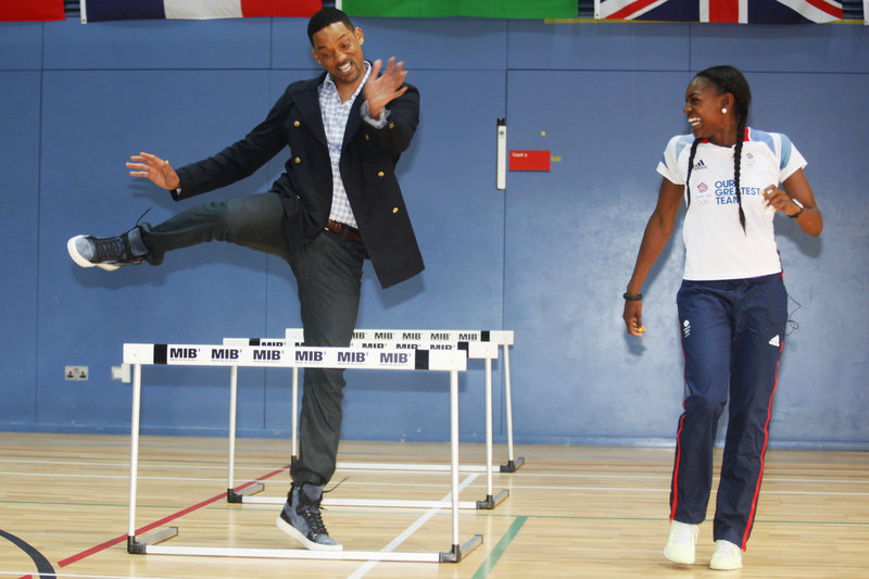 "Actor Will Smith tries the hurdles with Great Britain's 400-meter Olympic hurdler Perri Shakes-Drayton at Ethos gym in London on Wednesday. The Hollywood star took time out of his promotional schedule for ""Men in Black III"" to take a stab at some sports, before the U.K. premiere of the film later in the day. He praised the athleticism of those he met, confessing he has ""never been really athletic."""