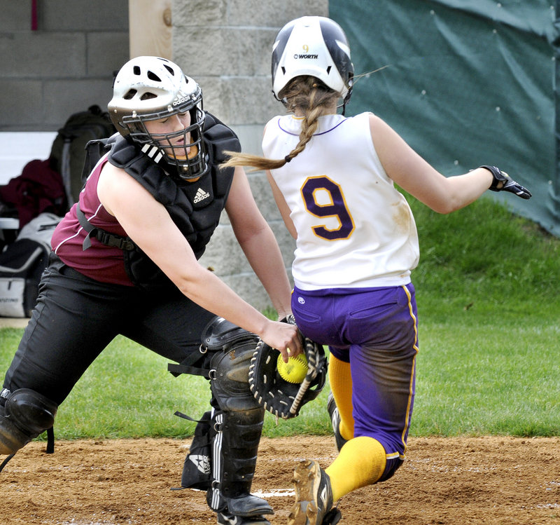 Gorham catcher Kara Stahl tags out Brittany Bell of Cheverus, who was attempting to score Wednesday during Cheverus' 6-1 victory in an SMAA softball game at Portland.
