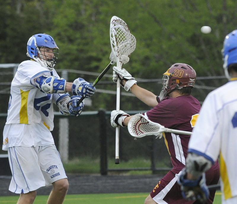 Charlie Fay of Falmouth, left, scores the fifth goal for the Yachtsmen, shooting past Will Goduti of Cape Elizabeth during the first half of the Yachtsmen's 14-12 victory Wednesday night. Each team has one boys' lacrosse loss this season – to the other.