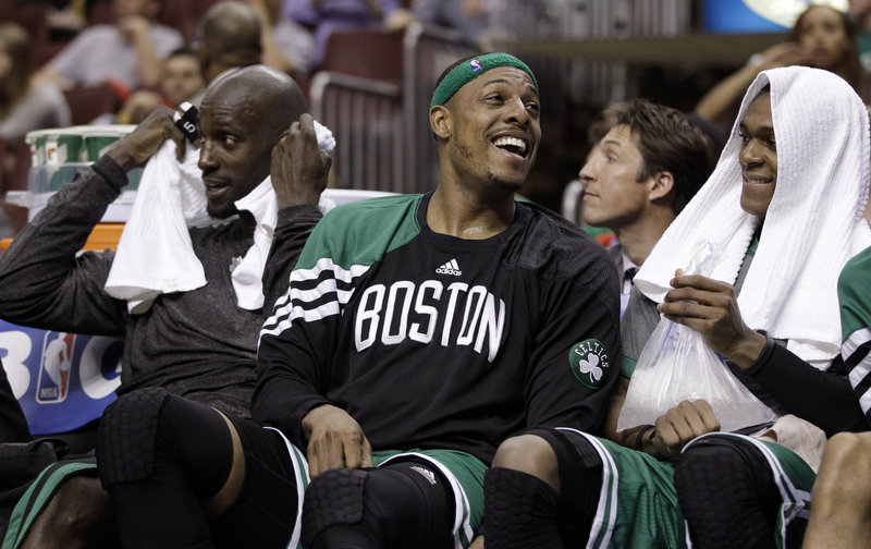 Paul Pierce, flanked by Kevin Garnett, left, and Rajon Rondo, had the chance to smile Wednesday night in the final moments of Boston's 107-91 victory.