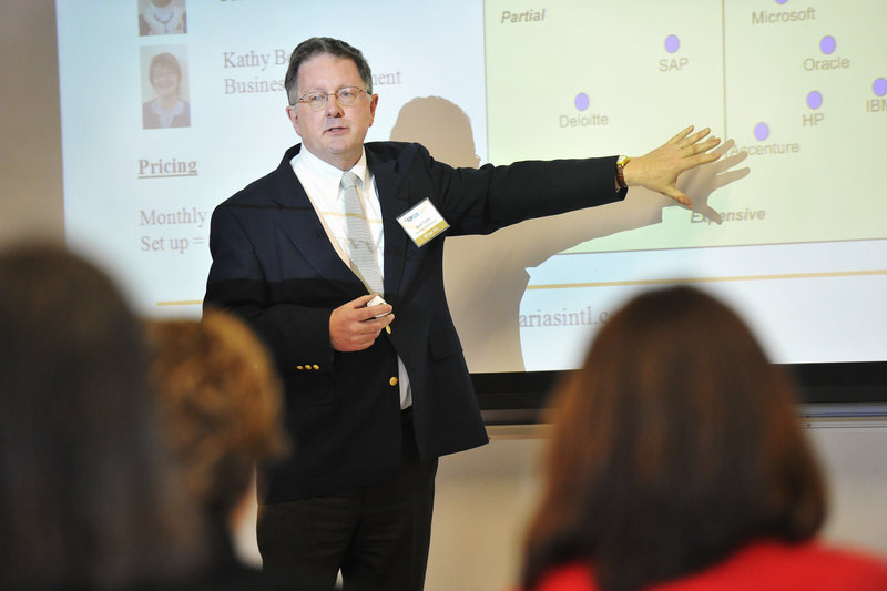 Mark Tuttle, owner of Azarias International, pitches his product to potential investors at USM. The presenters from the Maine Center for Entrepreneurial Development's Top Gun program had ideas for low-tech products such as custom shoe orthodics to high-tech items like software for architects.