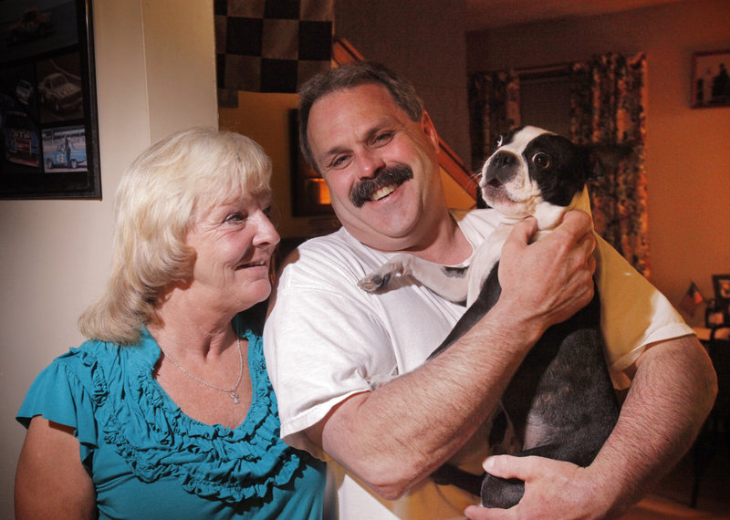 Laureen Rugen, her boyfriend, Don Merrill, and their dog Gizmo pose for a photo at their home in Naples. Since Rugen's graduation from trauma therapy, they are savoring her triumphs over fears and flashbacks from her years of abuse.