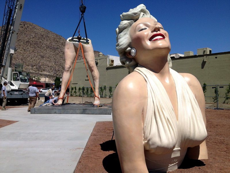 """Forever Marilyn"" is reassembled Monday at the corner of Palm Canyon Drive and Tahquitz Canyon Way in Palm Springs, Calif."