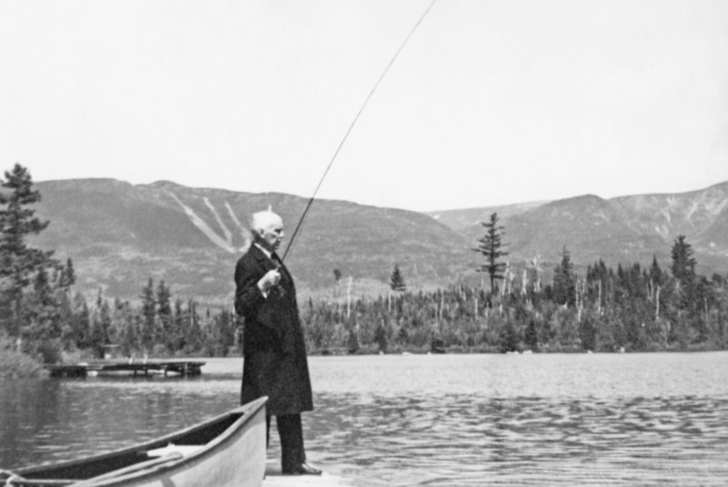 """Gov. Percival Baxter fly fishes at Kidney Pond in the shadow of Mount Katahdin in this 1931 photo from the book """"Baxter State Park and Katahdin."""" Baxter purchased the last of the 28 parcels that comprised the park 50 years ago this summer."""