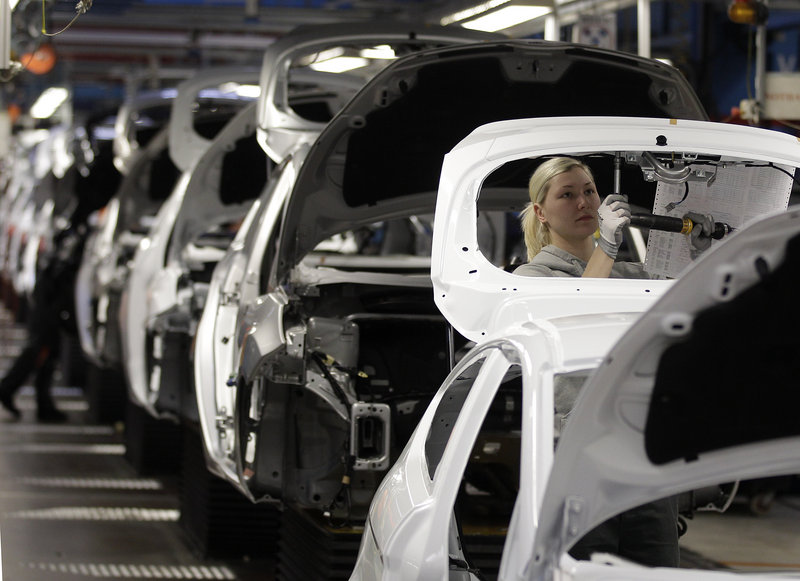 Workers assemble a Ford Fiesta on the production line of the car manufacturer in Cologne, Germany. Germany's unemployment is the lowest it's been since East and West Germany became one 22 years ago.