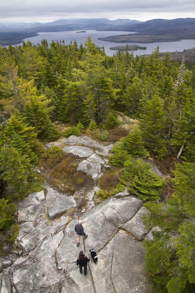 The payoff for hikers willing to endure the climb to the summit of Bald Mountain, humans and canines alike, is a breathtaking view of the Rangeley region.