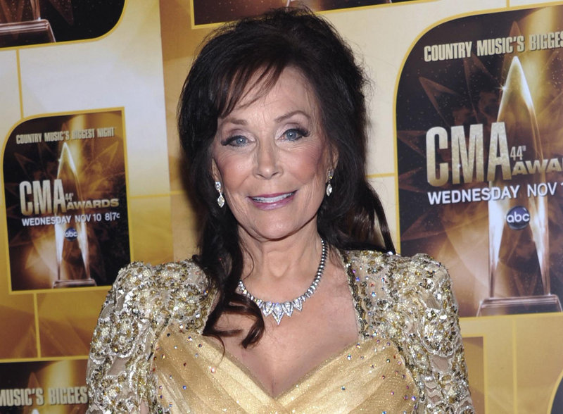 Country singer Loretta Lynn, who is now 80, poses in the press room during the 44th Annual Country Music Awards in Nashville, Tenn., in 2010.