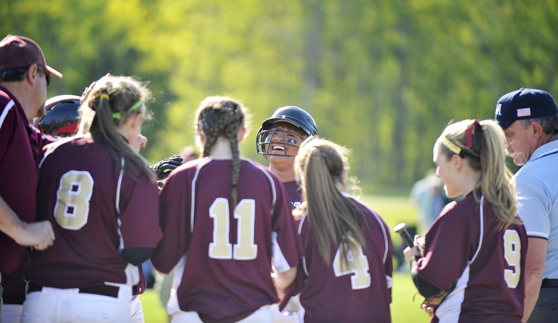 Meghan Agger of Thornton Academy is all smiles Friday, and why not? Her home run to center field in the fourth inning helped the Trojans recover from an early deficit on the way to a 4-3 victory against Kennebunk.