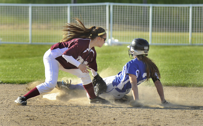 Meg Cadigan of Kennebunk slides safely into second base with a steal in the sixth inning as Thornton Academy shortstop Bailey Tremblay applies the tag.