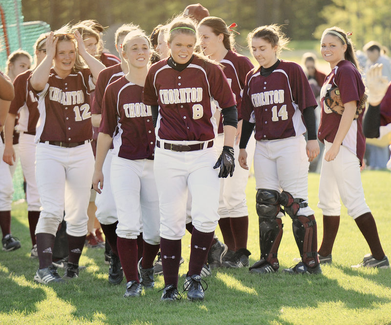 Julia Geaumont (8) is welcomed by teammates Friday after hitting a seventh-inning home run – her second homer of the game – to give Thornton Academy, which has a five-game winning streak, a 4-3 victory at home against Kennebunk.