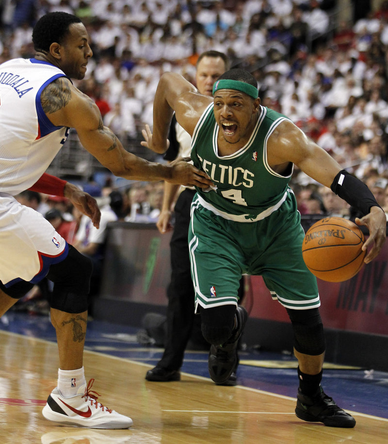 Paul Pierce, who scored 24 points Friday night for the Boston Celtics, drives against Andre Iguodala of the Philadelphia 76ers during the Sixers' 92-83 victory.