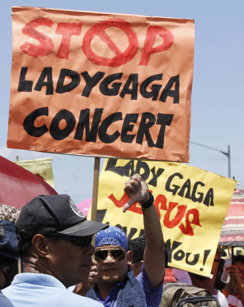Protesters turn out Saturday in Manila to greet Lady Gaga.