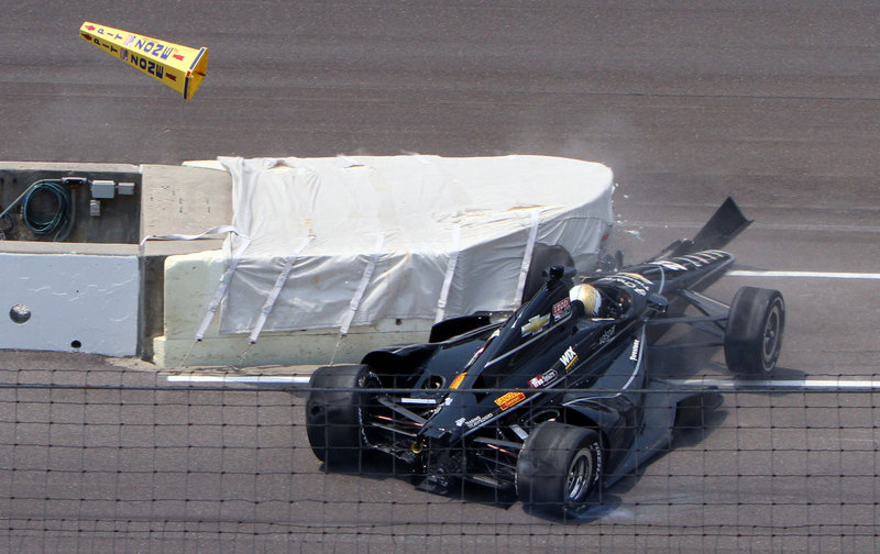 Oriol Servia crashes into a wall at the entrance to the pit area during the first day of qualifying for the Indianapolis 500. Servia will try again today to grab one of the nine remaining spots in the 33-car field for next Sunday's race.