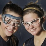 Westbrook athletes Emily Blackmore, left, and Tori Winton wear the two types of required eye protection for field hockey players.