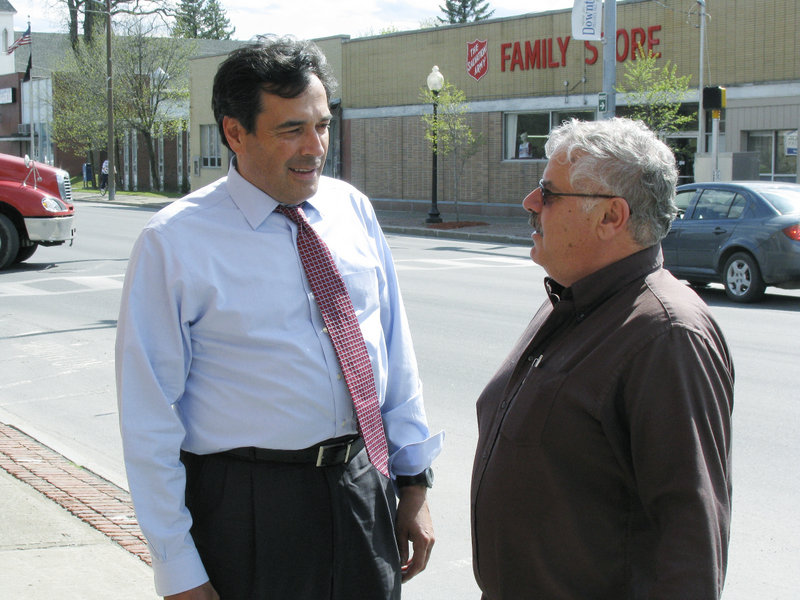 GOP Senate candidate Rick Bennett, left, talks with Rick Castonguay of Big Bear Real Estate on Main Street in Presque Isle on Friday.