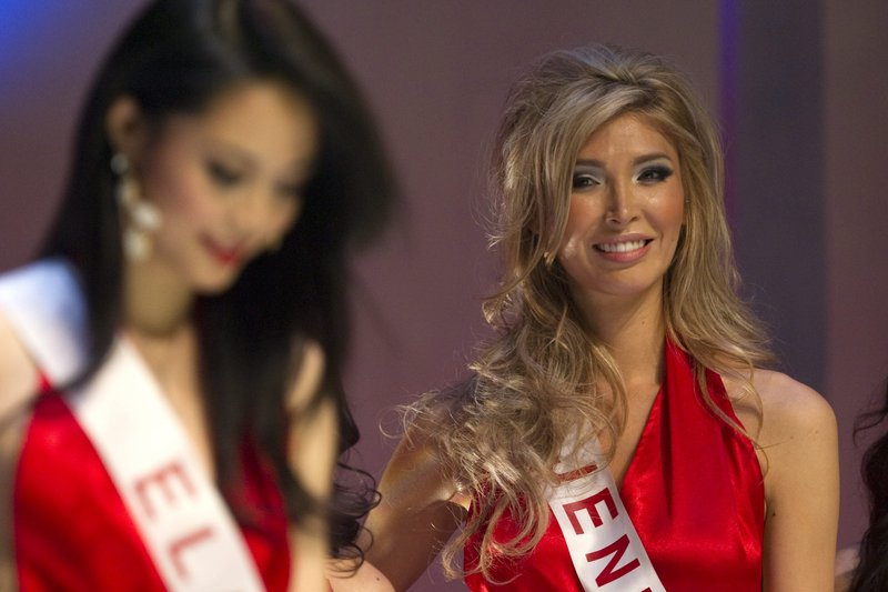 Jenna Talackova, right, the first transgender Miss Universe contestant, takes the stage Saturday in the Miss Universe Canada pageant.