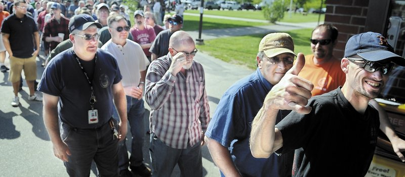 A member of Local S6 gives the thumbs-up Sunday before voting at the Augusta Civic Center on a new contract with Bath Iron Works. Members of the International Association of Machinists and Aerospace Workers voted to ratify the four-year agreement.