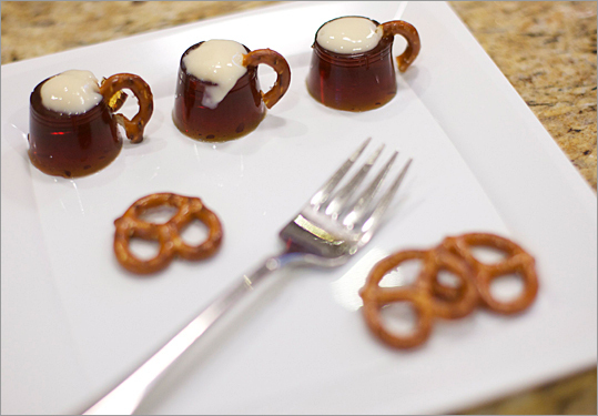 Matthew Micari's Rootbeer Mugs are made with root beer gelatin, topped with whipped foam and garnished with pretzel handles.