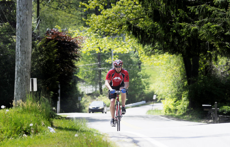A cyclist travels Shore Road on Monday. Walkers, joggers and cyclists currently use a narrow shoulder along the road.