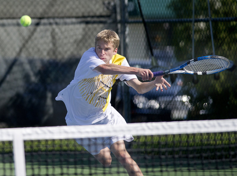 David Woodbury of Cheverus hits a forehand in his No. 1 singles match Monday against Ryan Johnson of Windham. Windham won 4-1 in the regular-season finale for both teams.