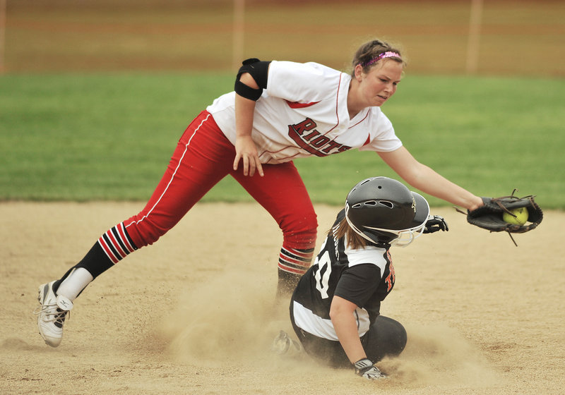 Biddeford's Kristina McCurry slides in safely before getting tagged by South Portland's Danica Gleason in Monday's game at Biddeford.