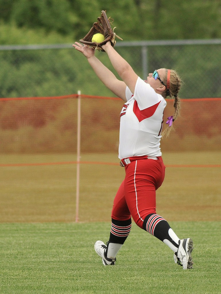 South Portland center fielder Olivia Indorf catches a fly ball during the Red Riots' 17-1 win Monday over Biddeford.