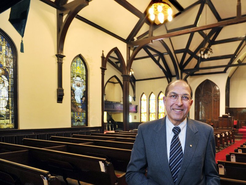 Frank Monsour stands in the sanctuary of the Williston-West church building he owns on Thomas Street.