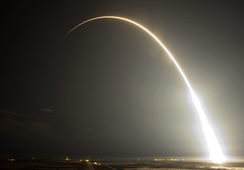 The Falcon 9 SpaceX rocket is seen during a time exposure, above, after it lifts off from the Cape Canaveral Air Force Station in Cape Canaveral, Fla., early Tuesday, below. This launch marks the first time a private company sends its own rocket to deliver supplies to the International Space Station.