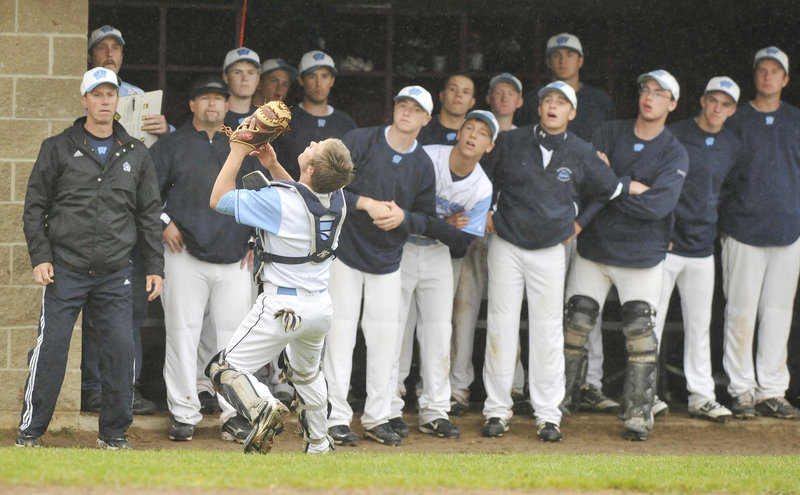 Westbrook catcher Kyle Heath gets plenty of encouragement Tuesday night while settling under a foul pop fly in front of the Blue Blazes' bench. Heath made the catch but Westbrook lost the Telegram League game at Scarborough, 2-0.