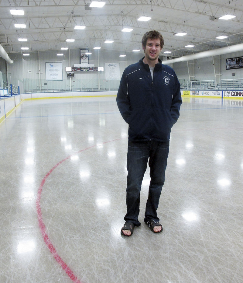 University of Connecticut hockey goalie Garrett Bartus poses on the rink at the Mark Edward Freitas Ice Forum on campus in Storrs, Conn. Bartus and his teammates have produced a video for the You Can Play project, pledging to accept any gay or transgender hockey player on their team.