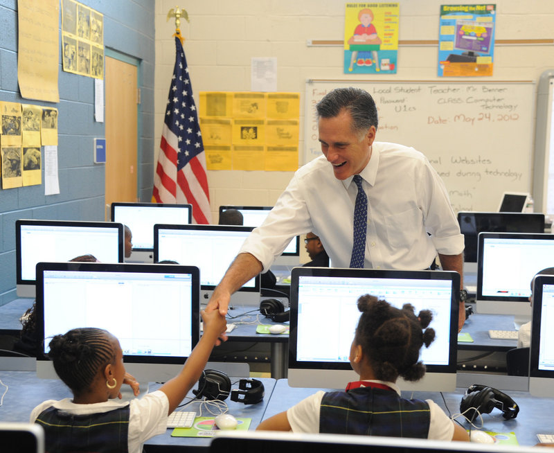 Republican presidential hopeful Mitt Romney greets students in a computer class at Universal Bluford Charter School in West Philadelphia, Pa., on Thursday.