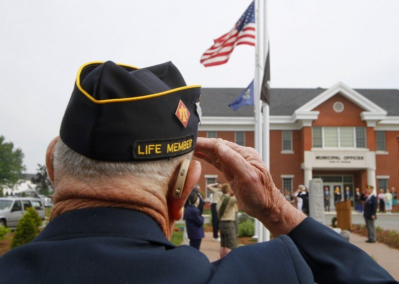 "Korean War veteran Gilbert Ormsby of American Legion Post 202 in Topsham salutes as the American flag is raised at Topsham Town Hall on May 31, 2010, before the start of the Memorial Day parade. A reader praises World War II and Korean War veterans for their service and says, ""Our last opportunities to recognize and thank them are upon us."""