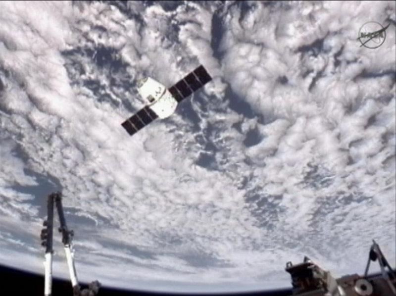 An image provided by NASA-TV shows the SpaceX Dragon commercial cargo craft as Dragon approaches the International Space Station on Friday. Dragon is scheduled to spend about a week docked with the station before returning to Earth on Thursday for retrieval.